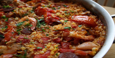 Chicken Paella is a Spanish dish that is full or flavor, and made easy by using a rotisserie chicken.