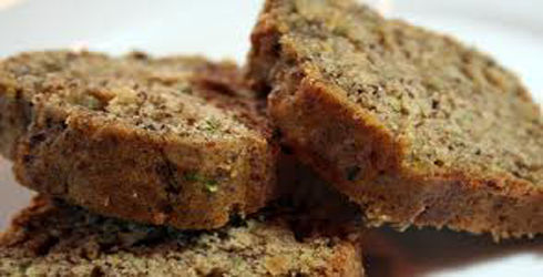 Zucchini Bread Recipe: Moist and delicious.  Perfect when company stops over and to give as a little housewarming gift.  This is a wonderful homemade treat!