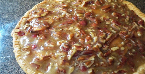 Cranberry Apple Pie with Sweet Walnut Topping is a nice alternative to the traditional apple pie.  The topping is like candy coated nuts, to the fullest!