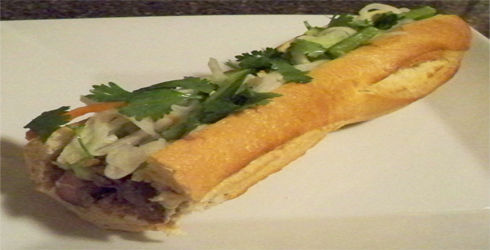 Banh mi is a Vietnamese sandwich made with marinated meat or tofu that packs a serious flavor punch.  The veggies and slaw are unique to Banh mi, and will leave you wanting more.