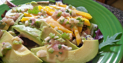 Mango and Avocado Salad with Peanut Dressing is something you will want to eat nearly every day.  This salad can be served as a starter dish or pile it up to make a super refreshing lunch to get you through the hot days.