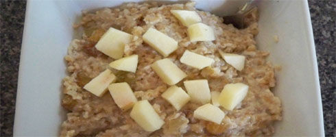 Oven Apple Oats is a very creamy and fluffy oatmeal that is lighter than bread pudding, but somewhat reminiscent of it. This sweet combination of apples, maple syrup, and currants is one of The Hungry Wife's favorite oatmeals.