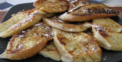 "French toast is called Pain Perdu, or ""lost bread,"" because it is made from stale bread.  What makes this Pain Perdu Breakfast different from regular French toast, hard bread is softened by dipping in a mixture of milk and eggs, then deep fried."