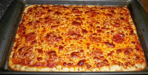 Sicilian Pizza is characterized by a thicker dough, and less sauce, cheese and other toppings than traditional American pizzas.  This recipe is amazing!